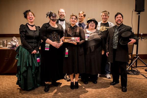 A group of singers in costume at Arisia, photo by Cat Trzaskowski